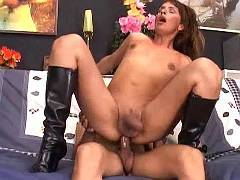 Horny transsexual in boots wild fucking on sofa