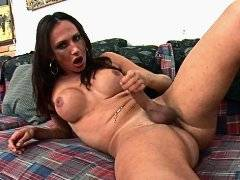 Busty tranny plays with tasty ass and her big cock